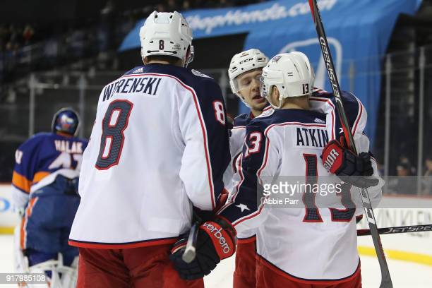 Artemi Panarin of the Columbus Blue Jackets celebrates with teammates after scoring a goal against the New York Islanders in the third period during...