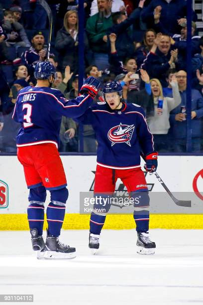 Artemi Panarin of the Columbus Blue Jackets congratulates Seth Jones of the Columbus Blue Jackets after scoring a power play goal during the first...