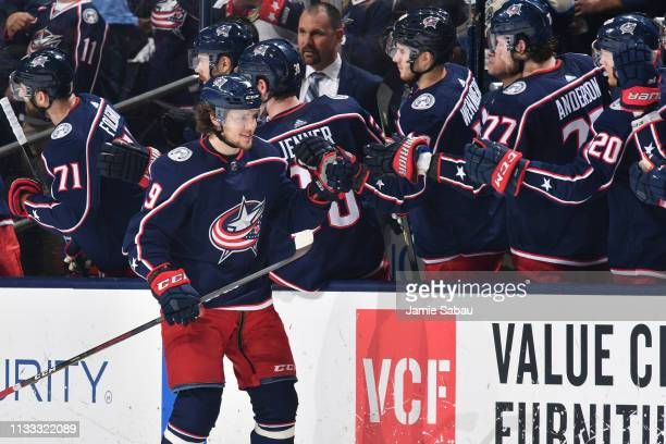 Artemi Panarin of the Columbus Blue Jackets highfives his teammates after scoring a goal during the second period of a game against the Montreal...