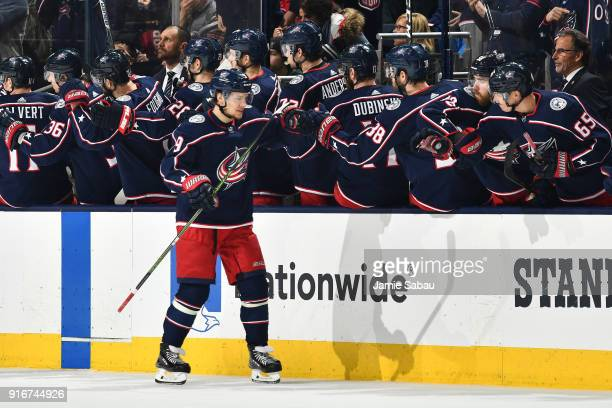 Artemi Panarin of the Columbus Blue Jackets highfives his teammates after scoring a goal during the second period of a game against the New Jersey...
