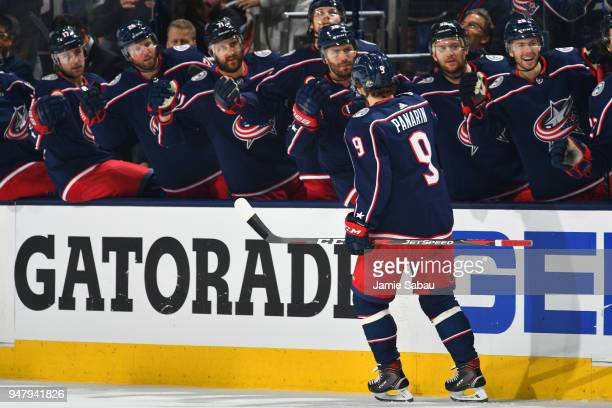 Artemi Panarin of the Columbus Blue Jackets highfives his teammates after scoring a goal during the third period against the Washington Capitals in...