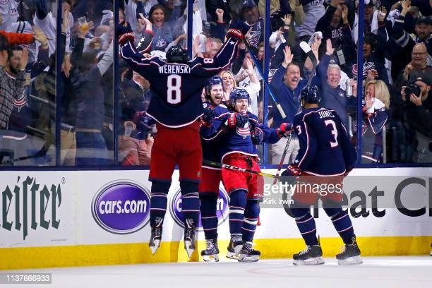 Artemi Panarin of the Columbus Blue Jackets is congratulated by teammates after scoring an empty net goal during the third period of Game Four of the...