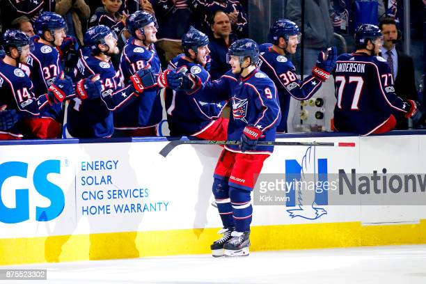 Artemi Panarin of the Columbus Blue Jackets is congratulated by his teammates after scoring a goal during the third period of the game against the...