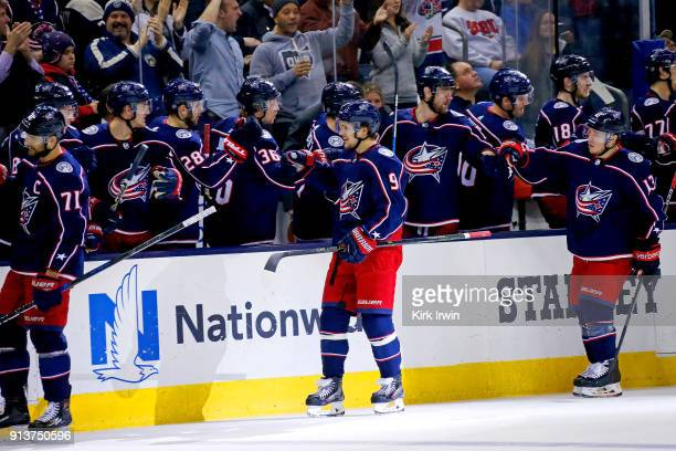 Artemi Panarin of the Columbus Blue Jackets is congratulated by his teammates after scoring a goal during the game against the Minnesota Wild on...