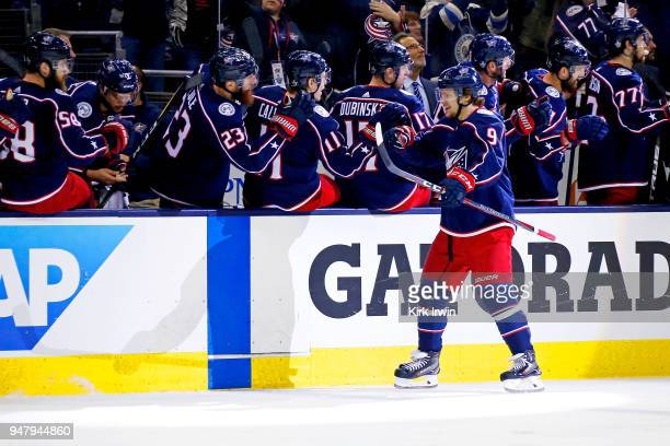 Artemi Panarin of the Columbus Blue Jackets is congratulated by his teammates after scoring a goal against the Washington Capitals during the third...