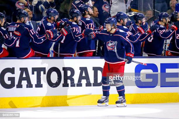 Artemi Panarin of the Columbus Blue Jackets is congratulated by his teammates after scoring a goal in Game Three of the Eastern Conference First...