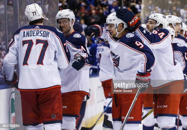 Artemi Panarin of the Columbus Blue Jackets is congratulated on his game winning overtime goal against the Toronto Maple Leafs by teammates Josh...