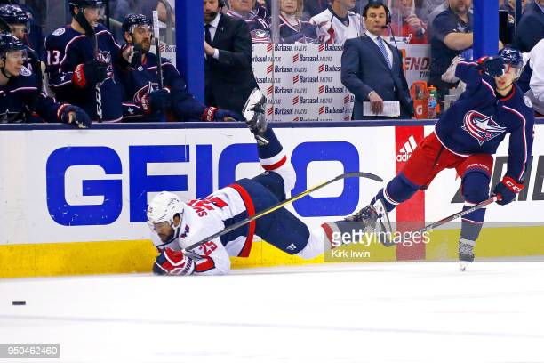 Artemi Panarin of the Columbus Blue Jackets knocks down Devante SmithPelly of the Washington Capitals while chasing after a loose puck during the...