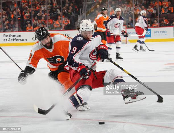 Artemi Panarin of the Columbus Blue Jackets loses his balance on a check from Radko Gudas of the Philadelphia Flyers during the third period at the...
