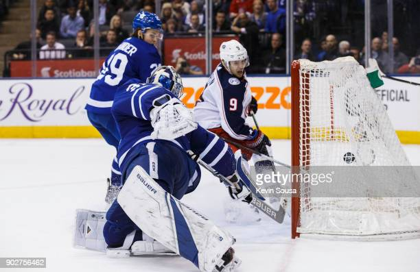 Artemi Panarin of the Columbus Blue Jackets scores the game winning goal past Frederik Andersen and William Nylander of the Toronto Maple Leafs...