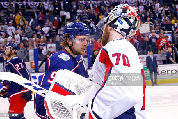 Artemi Panarin of the Columbus Blue Jackets shakes hands with Braden Holtby of the Washington Capitals at the end of Game Six of the Eastern...