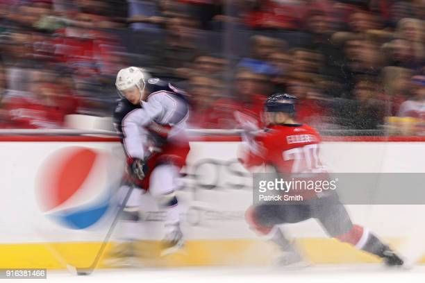 Artemi Panarin of the Columbus Blue Jackets skates past Lars Eller of the Washington Capitals during the second period at Capital One Arena on...