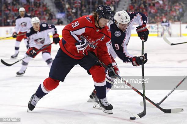 Artemi Panarin of the Columbus Blue Jackets skates past Nicklas Backstrom of the Washington Capitals during the first period at Capital One Arena on...