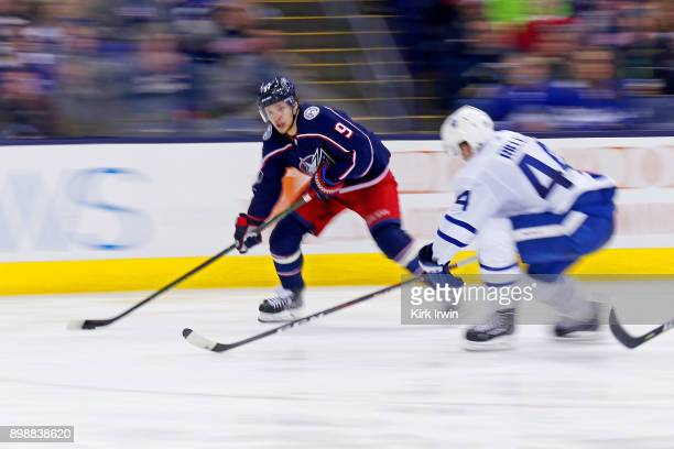 Artemi Panarin of the Columbus Blue Jackets skates the puck past Morgan Rielly of the Toronto Maple Leafs during the game on December 20 2017 at...