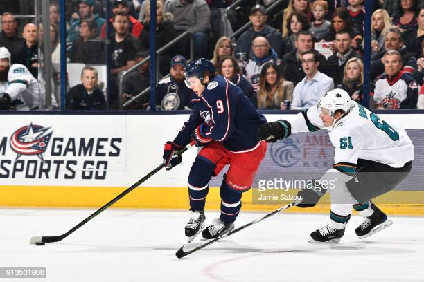 Artemi Panarin of the Columbus Blue Jackets skates with the puck as Justin Braun of the San Jose Sharks defends during the first period of a game on...