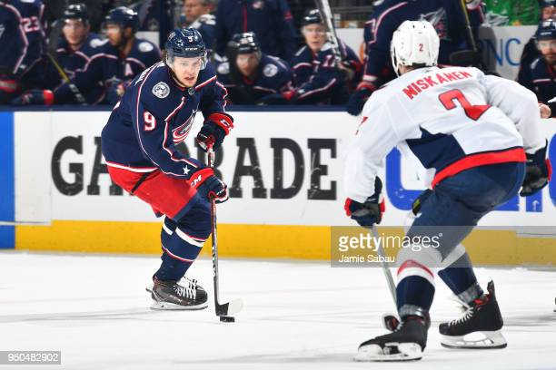 Artemi Panarin of the Columbus Blue Jackets skates with the puck as Matt Niskanen of the Washington Capitals defends during the third period in Game...