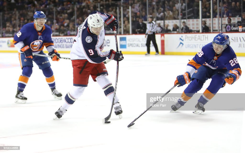 Artemi Panarin #9 of the Columbus Blue Jackets takes a shot against Sebastian Aho #28 of the New York Islanders in the first period during their game at Barclays Center on February 13, 2018 in the Brooklyn borough of New York City.