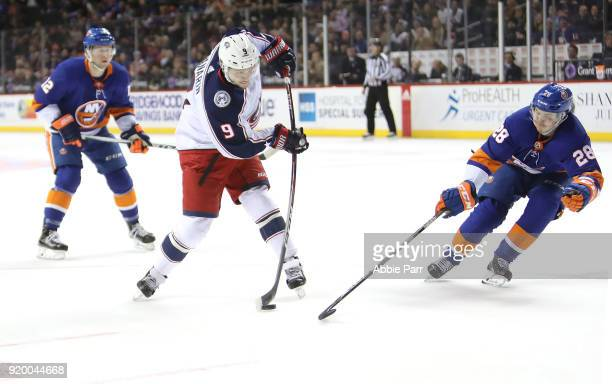 Artemi Panarin of the Columbus Blue Jackets takes a shot against Sebastian Aho of the New York Islanders in the first period during their game at...