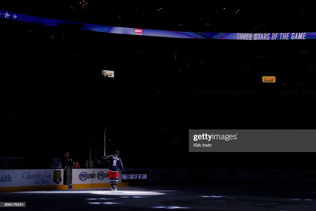 Artemi Panarin #9 of the Columbus Blue Jackets waves to the crowd after being named the game's number one star after defeating the New York Islanders 5-0 on October 6, 2017 at Nationwide Arena in Columbus, Ohio.