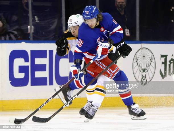 Artemi Panarin of the New York Rangers attempts to get past Patrice Bergeron of the Boston Bruins during the third period at Madison Square Garden on...