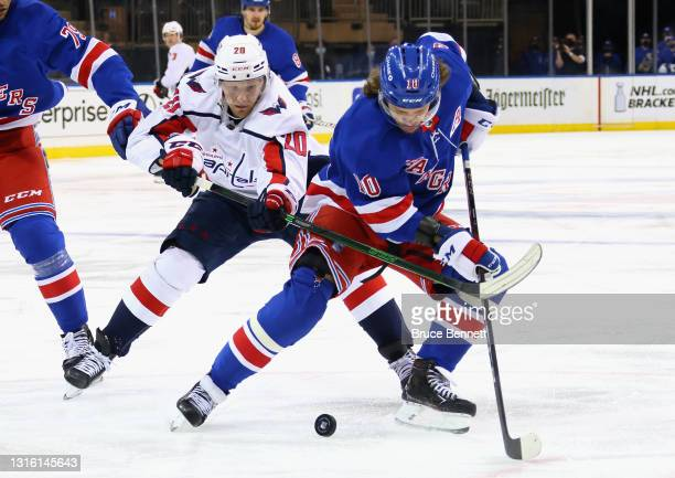 Artemi Panarin of the New York Rangers carries the puck past Lars Eller of the Washington Capitals during the first period at Madison Square Garden...