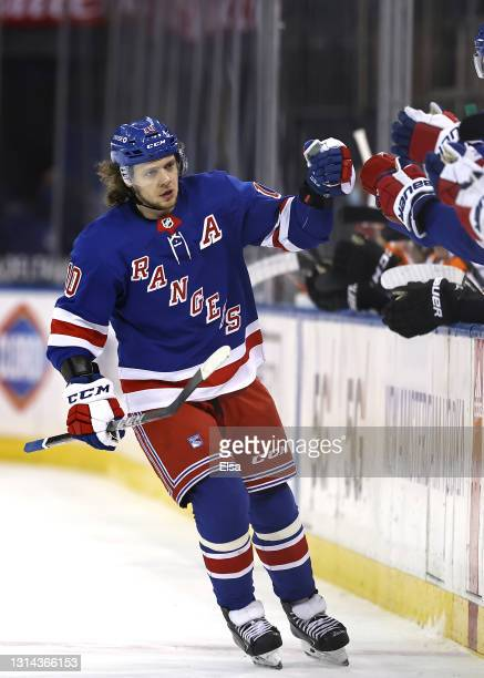 Artemi Panarin of the New York Rangers celebrates his goal with teammates on the bench in the third period against the Philadelphia Flyers at Madison...