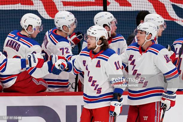 Artemi Panarin of the New York Rangers celebrates with his teammates after scoring a goal against the Washington Capitals in the first period at...