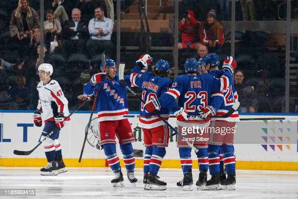 Artemi Panarin of the New York Rangers celebrates with teammates after scoring a goal in the second period against the Washington Capitals at Madison...
