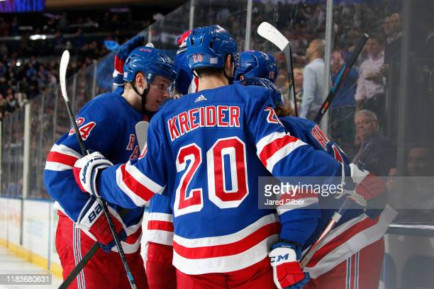 Artemi Panarin of the New York Rangers celebrates with teammates after scoring a goal in the third period against the Washington Capitals at Madison...