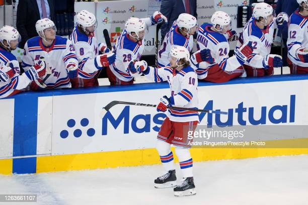 Artemi Panarin of the New York Rangers celebrates with teammates after scoring a goal against the Carolina Hurricanes in Game Two of the Eastern...