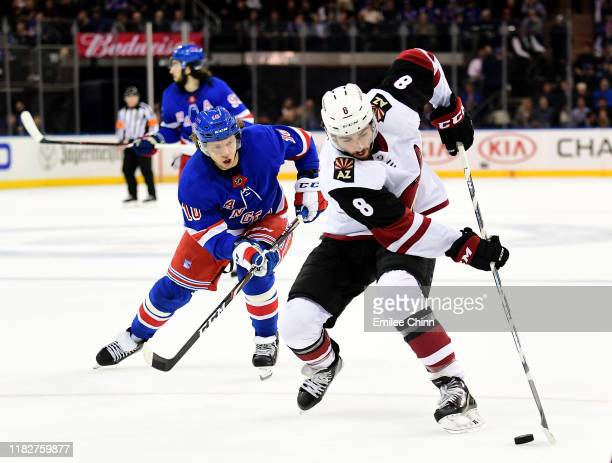 Artemi Panarin of the New York Rangers chases Nick Schmaltz of the Arizona Coyotes as he controls the puck in the first quarter of their game at...