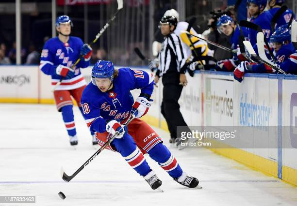 Artemi Panarin of the New York Rangers controls the puck during their game against the Pittsburgh Penguins at Madison Square Garden on November 12...