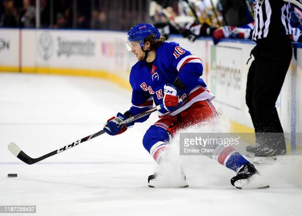 Artemi Panarin of the New York Rangers cuts the ice and controls the puck during the second period of their game against the Pittsburgh Penguins at...