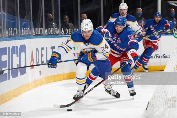 Artemi Panarin of the New York Rangers defends against Dylan Cozens of the Buffalo Sabres at Madison Square Garden on April 27, 2021 in New York City.