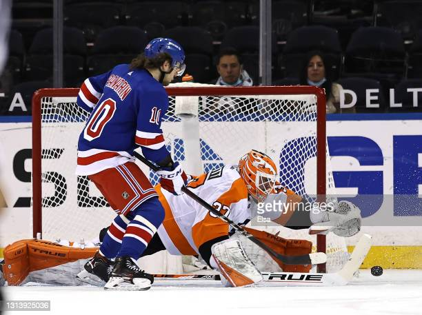 Artemi Panarin of the New York Rangers heads for the net as Brian Elliott of the Philadelphia Flyers defends in the first period at Madison Square...