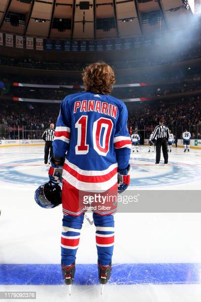 Artemi Panarin of the New York Rangers looks on during the national anthem prior to the game against the Winnipeg Jets at Madison Square Garden on...