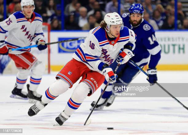 Artemi Panarin of the New York Rangers looks to pass during a game against the Tampa Bay Lightning at Amalie Arena on November 14 2019 in Tampa...