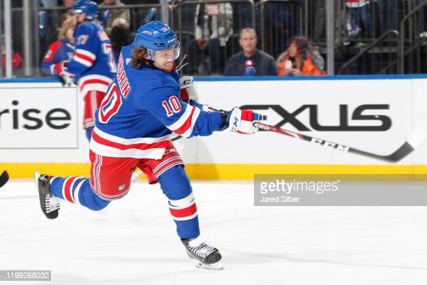 Artemi Panarin of the New York Rangers shoots the puck during warmups prior to the game against the Buffalo Sabres at Madison Square Garden on...