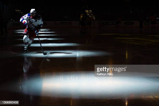 Artemi Panarin of the New York Rangers skates into the spotlight during warmups prior to the start of the game against the Boston Bruins at TD Garden...