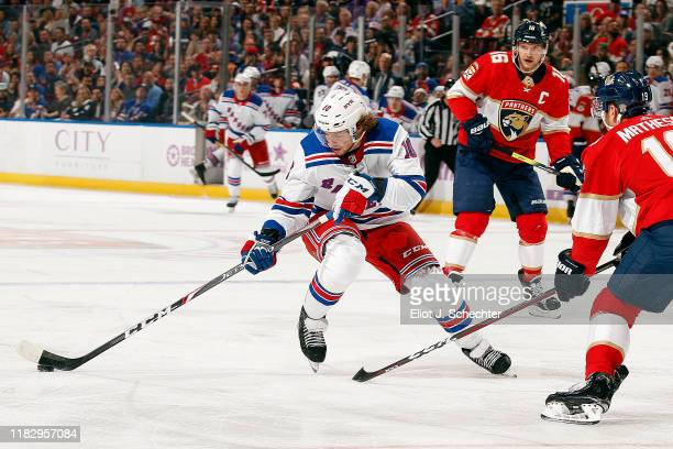 Artemi Panarin of the New York Rangers skates with the puck against Michael Matheson of the Florida Panthers at the BBT Center on November 16 2019 in...