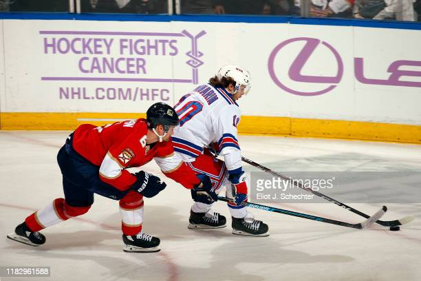 Artemi Panarin of the New York Rangers skates with the puck against Anton Stralman of the Florida Panthers at the BBT Center on November 16 2019 in...