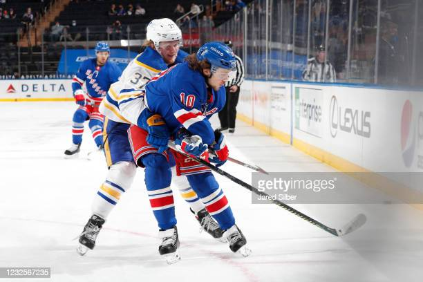 Artemi Panarin of the New York Rangers skates with the puck against Casey Mittelstadt of the Buffalo Sabres at Madison Square Garden on April 27,...
