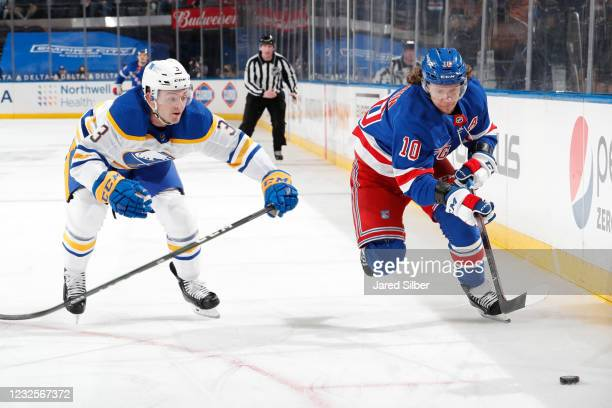 Artemi Panarin of the New York Rangers skates with the puck against William Borgen of the Buffalo Sabres at Madison Square Garden on April 27, 2021...