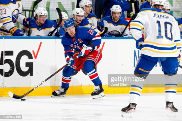 Artemi Panarin of the New York Rangers skates with the puck against Henri Jokiharju of the Buffalo Sabres at Madison Square Garden on April 27, 2021...
