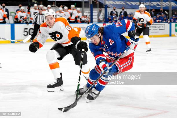 Artemi Panarin of the New York Rangers skates with the puck against Justin Braun of the Philadelphia Flyers at Madison Square Garden on April 22,...