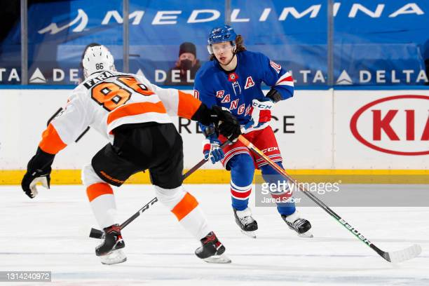 Artemi Panarin of the New York Rangers skates with the puck against Joel Farabee of the Philadelphia Flyers at Madison Square Garden on April 22,...