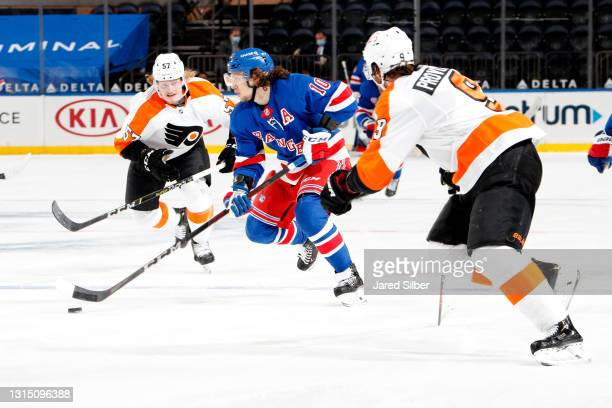Artemi Panarin of the New York Rangers skates with the puck against Ivan Provorov of the Philadelphia Flyers at Madison Square Garden on April 23,...