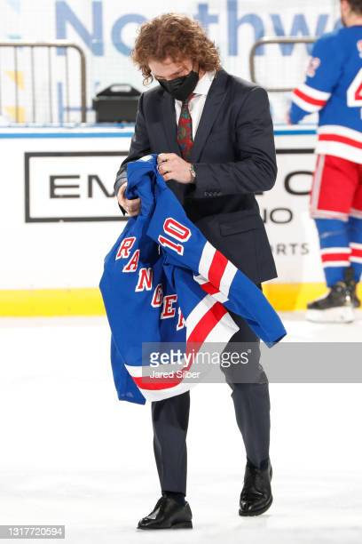 Artemi Panarin of the New York Rangers takes his jersey off during the Blueshirts Off Our Back ceremony following the game against the Washington...