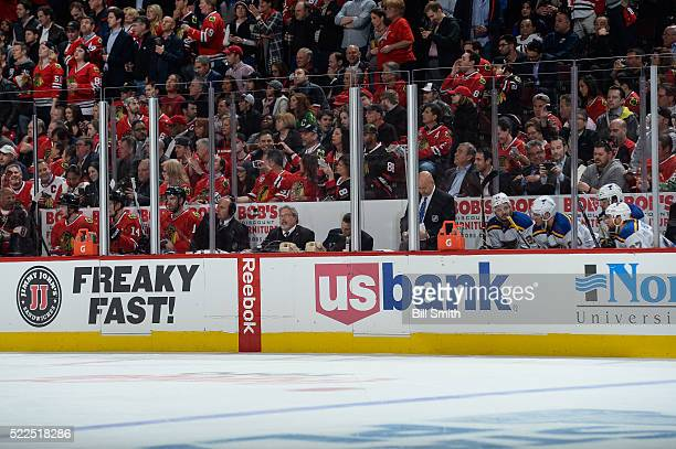 Artemi Panarin, Richard Panik and Andrew Ladd of the Chicago Blackhawks sit in the penalty box as Kevin Shattenkirk, Alexander Steen, Robby Fabbri...