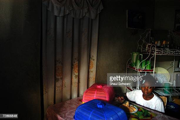 Arthemise Jean 12yearsold eats a plate of macaroni noodles at her host family's home on April 6 2005 in PortauPrince Haiti One of seven children from...